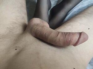 Schoolgirl relative to stockings gives footjob to big cock